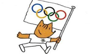 Cobi, la mascota de Barcelona 92, con la bandera olímpica.
